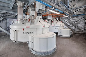 """<div class=""""bildtext_en"""">Two Pemat PMPR 3000 planetary mixers with whirler were used, each with a compacted concrete output of 2 cbm</div>"""