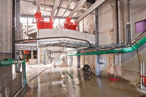 """<div class=""""bildtext_en"""">These two mixers are equipped with two discharge doors so that every mixer can feed the material into one of two bucket conveyor systems</div>"""