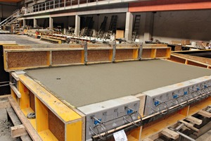 """<div class=""""bildtext_en"""">View into the production hall: precast balconies with Isokorb elements of Schöck, just being concreted</div>"""