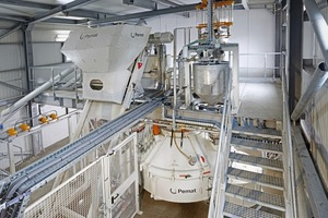 """<div class=""""bildtext_en"""">A Pemat inclined hoist passes the aggregates to a PMPR 2250 Pemat planetary mixer fitted with whirlers</div>"""