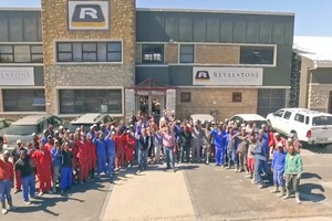 "<div class=""bildtext_en"">The Revelstone workforce in front of the company building, with managing directors Andrew and Alex Cyprianos pictured in the center</div>"