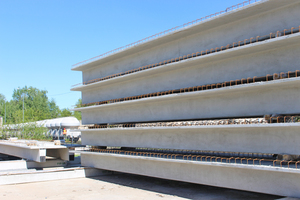 """<div class=""""bildtext_en"""">These double T floor slabs have been put to storage to be transported to the job site, …</div>"""