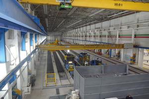 """<div class=""""bildtext"""">Mit dem von Echo Precast Engineering gelieferten Gleitfertiger T40 produziert Erel auf sechs jeweils 120m langen Produktionsbahnen 15bis40cm dicke Spannbeton-Hohldecken </div>"""