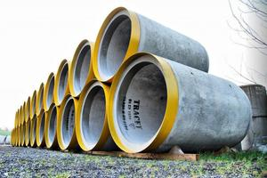 """<div class=""""bildtext_en""""><irspacing style=""""letter-spacing: -0.035em;""""><irfontsize style=""""font-size: 7.250000pt;"""">Finished concrete pipes waiting for their onward transport to the construction site </irfontsize></irspacing></div>"""
