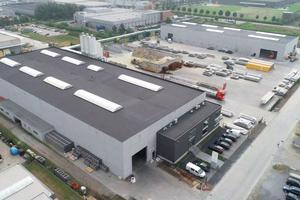 "<div class=""bildtext_en"">Air view of the new Predalco precast concrete plant in Belgium</div>"