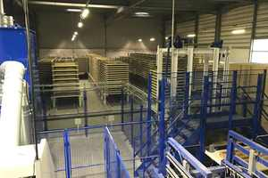 "<div class=""bildtext_en"">The curing area is designed to accommodate up to 5,400 pallets</div>"