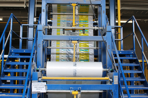 """<div class=""""bildtext_en"""">In the final step of production, the concrete slabs pass through the packaging machine …</div>"""