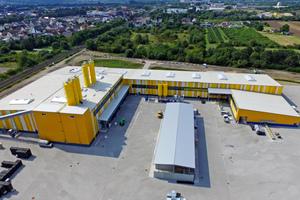 "<div class=""bildtext_en"">The new KANN concrete slab plant in Urmitz viewed from the bird's eye perspective</div>"