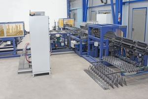 """<div class=""""bildtext_en"""">PLT B Spacer machine with automatic stacking unit </div>"""