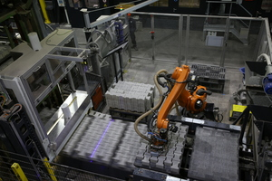 "<div class=""bildtext_en"">The highlight of the factory tour is the orange-colored Kuka robot called ""Wall-E""</div>"
