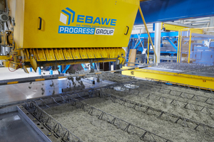 "<div class=""bildtext_en""><irspacing style=""letter-spacing: -0.03em;"">The new concrete spreader places the concrete of the precast floor slabs and double wall elements in a fully automated process</irspacing></div>"