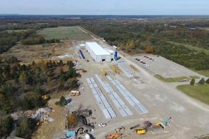 """<div class=""""bildtext_en"""">Charlestown factory aerial view</div>"""