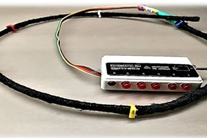 "<div class=""bildtext_en"">Fig. 10: Six-zone cable humidity sensor with indicator unit for critical excess of humidity in the control zones</div>"