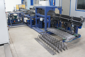 """<div class=""""bildtext_en"""">PLT B Spacer machine with automatic stacking unit</div>"""