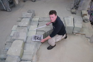"""<div class=""""bildtext_en""""><irspacing style=""""letter-spacing: -0.015em;"""">Markus Madeia, stonemason and restorer, is explaining the new construction</irspacing></div>"""