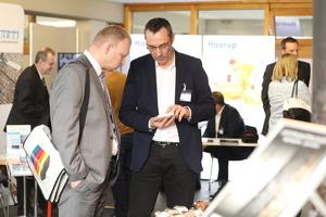 """<div class=""""bildtext"""">In der begleitenden Fachausstellung der Zulieferindustrie informieren sich traditionell mehr als 2.000 BetonTage-Teilnehmer</div>"""