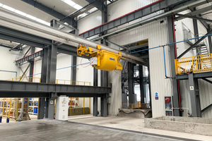 """<div class=""""bildtext_en"""">The concreting process is supplied via a specially designed bucket conveyor system</div>"""