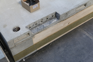 """<div class=""""bildtext_en""""><irspacing style=""""letter-spacing: -0.01em;"""">Fig. 7: Demolded floor slab from Fig. 4 with blockout for the BT turnbuckles</irspacing></div>"""
