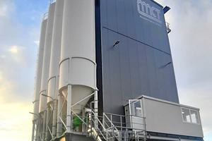 """<div class=""""bildtext_en"""">The new tower mixing plant after completion</div>"""