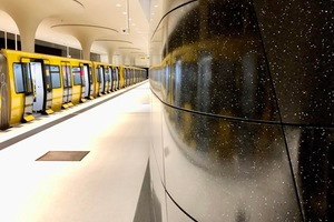 """<div class=""""bildtext_en"""">Black-and-white textile-reinforced concrete terrazzo in the new """"Rotes Rathaus"""" subway station</div>"""