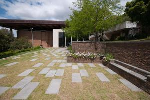 """<div class=""""bildtext_en"""">The revamped Baxter Theatre garden showing the terraces, stairs and the retaining wall …</div>"""