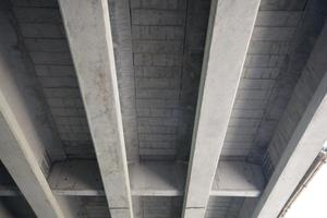 "<div class=""bildtext_en"">The underside of the newly constructed river bridge showing the T-beams and the permanent concrete shuttering</div>"