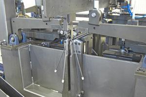 """<div class=""""bildtext"""">Produktion von individuellen Abstandsböcken mit Kunststoff-Füßen</div>"""