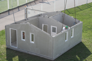 """<div class=""""bildtext_en""""><irspacing style=""""letter-spacing: -0.02em;"""">Erection of the first prototype of the """"Low Cost House"""" – erected in two hours </irspacing></div>"""