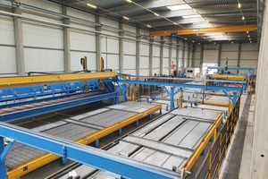 """<div class=""""bildtext_en"""">Extended view of the plant with the automatic wire processing units as well as the fully automatic shuttering robot&nbsp;</div>"""