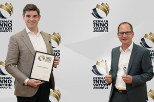 """<div class=""""bildtext_en"""">Mike Bucher (Chairman of the Executive Board) and Werner Venter (Product Manager of Isolink) are pleased about the special award</div>"""