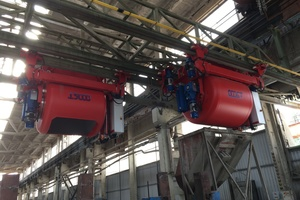 """<div class=""""bildtext_en"""">Flying buckets in the existing rails looking at the switch area towards the batching plant</div>"""