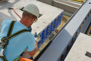 """<div class=""""bildtext_en"""">View of the slim-floor slab supports running flush with the floor slab</div>"""