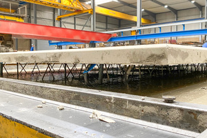 """<div class=""""bildtext_en""""><irspacing style=""""letter-spacing: -0.005em;"""">The lattice girders produced on the machines provide the reinforcement for precast walls and floor slabs to be subsequently filled with concrete on the job site for installation readiness </irspacing></div>"""