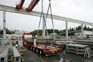 "<div class=""bildunterschrift_en"">Daily Truck-loading of the precast concrete elements to transport them to the Swiss construction site</div>"
