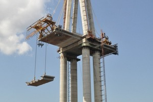 A crane carried the base plates directly from the raft to the final position