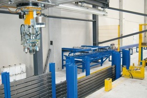 Fig. 6 Roller conveyor with identification system in the area of the shuttering robot.