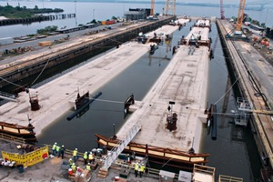 """<div class=""""bildtext_en"""">The tunnel segments are ready for transport to the Elizabeth River </div>"""