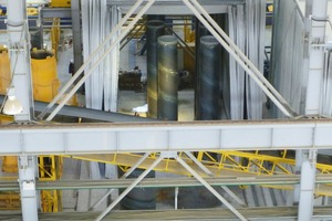 """<div class=""""bildtext_en"""">The steel cylinders casted with concrete harden in separate drying chambers (kilns) in vertical position</div>"""