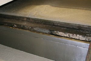 """<span class=""""bildunterschrift_hervorgehoben"""">Fig. 4</span> In the foreground, a mold is located in which the aerated concrete is rising. The concrete mix above has reached its full expansion level  after only a few minutes, and is then transported to the     curing chamber.<br />"""