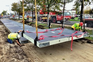 Dutch company Solaroad has developed 2.5 x 3.5 m concrete slabs in which solar modules are inserted on the top side. These modules are protected by a specially designed, 10 mm thick glass layer that lets sunlight pass through, prevents soiling, and has anti-slip properties