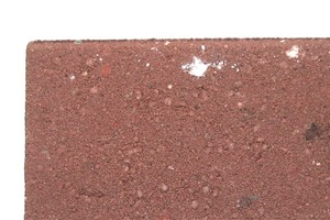 """<span class=""""bildunterschrift_hervorgehoben"""">Fig. 2</span> Agglomerates of TiO<sub>2</sub> formed at the surface of a concrete paving block."""