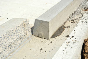 "<div class=""bildtext_en"">All curbs are cut to the same height. The concrete surface of the roadway is blasted by water jetting. Then the curbstones are glued to the cut side in a thin-bed process with two-component adhesive</div>"