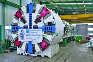 """<span class=""""bildunterschrift_hervorgehoben"""">Fig. 10</span> A masterpiece of tunneling technology: The driving machine, weighing over 1300 tons and 65m long in the factory hall of Herrenknecht awaiting transport to the construction site.<br />"""