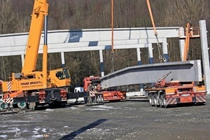 """<div class=""""bildtext_en"""">A total of 92 reinforced-concrete columns and wall slabs as well as 10 beams of 33-m length were delivered and erected</div>"""