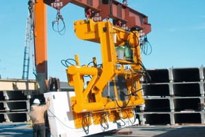 Fig. 1 As in the USA heavy loads are often handled and space is not an issue; A vacuum lifting and 90 degree turning device with a capacity of 24 ton manipulating a prestressed spandrel panel.