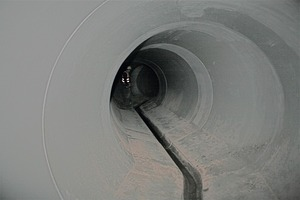 """Fig. 4 and 5 A widely branching sewer network had to be newly constructed and/or rerouted, in many cases along the building fronts. The pictures give an impression of the """"underworld"""" with deep manholes and partly pronouncedly curved pipe routings, all of which made of high-quality  reinforced-concrete system elements."""