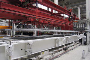 Following the curing process, at first, the upper shells are taken from the shuttering pallet and are positioned onto the vacuum suction cups of the turning device by means of a lifting device