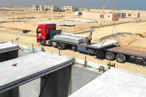 Hollow-core elements being installed on total precast villas, Jubail, S.A.