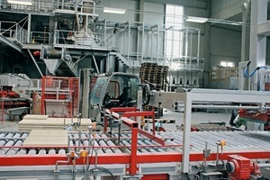 """<div class=""""bildtext_en"""">SR Schindler supplied the plant equipment for the slab produc- tion; the Eirich mixer in the background</div>"""