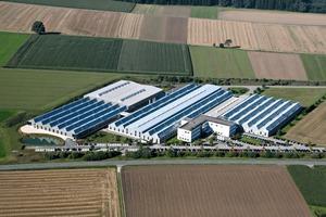 "<div class=""bildtext_en"">Today's production site in Dürmentingen, with a total production area of 37,000 m²</div>"